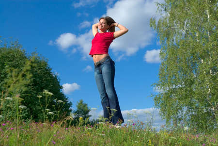 strenght: Beautiful lady jumping in summer landscape
