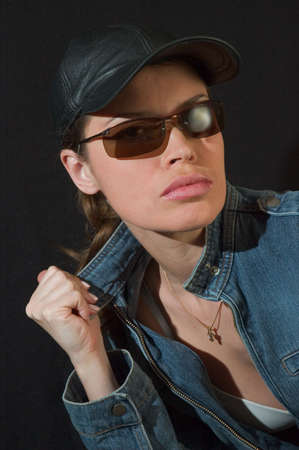 Lady in jeans jacket and black glasses