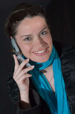 Lady in black glasses talking by mobile phone