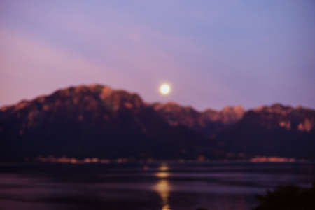 Moon, mountains, and lake blurred