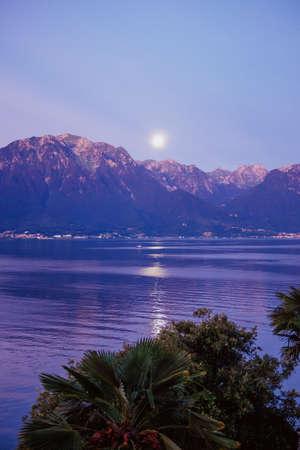 Moon, mountains, and lake Фото со стока