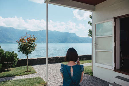 Young woman in the yard of Villa Le Lac in Vevey