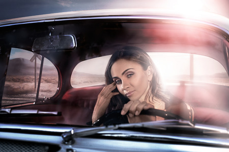 elegance fashion girls look sensuality young:  Beautiful sexy girl in expensive black car Stock Photo