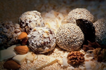 Sweets balls with walnuts and almonds photo