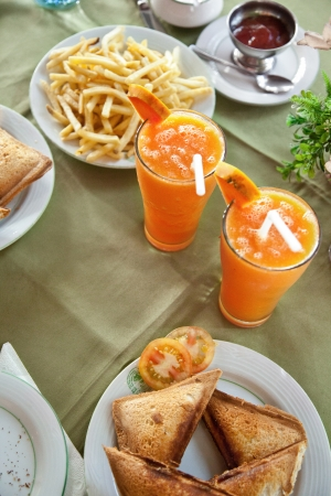 Pumpkin juice in a glass and an appetizer photo