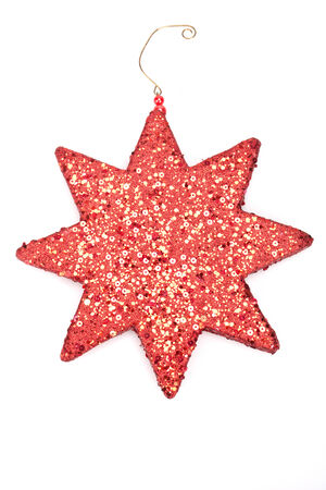 A red glitter star isolated on white background photo
