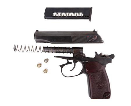 Disassembled gun isolated on white background photo