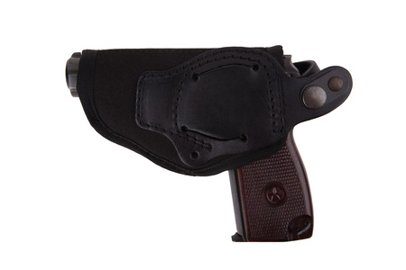 Gun in textile holster isolated on white background photo