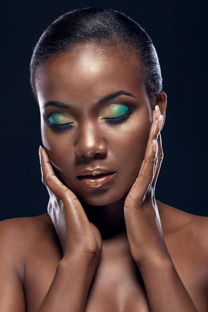 brown hair blue eyes: Beauty portrait of handsome ethnic african girl with closed eyes, on dark background Stock Photo
