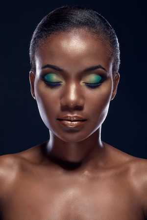 shiny black: Beauty portrait of handsome ethnic african girl with closed eyes, on dark background Stock Photo