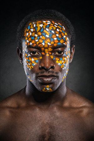 african culture: Beauty portrait of handsome ethnic african male with creative make-up