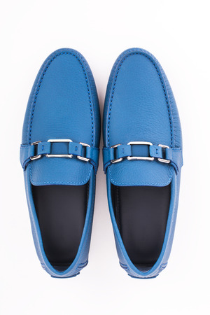 Blue male leather loafers pair isolated on white background Stock Photo