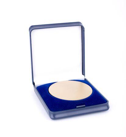 Golden medal in a blue case photo