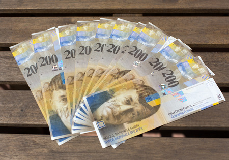 denomination: Swiss Francs, denomination of  200 on a wooden background Stock Photo