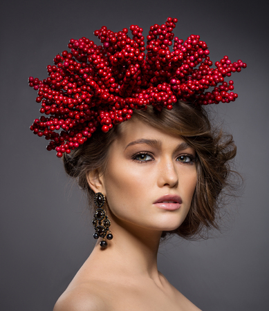 bronzed: Beauty portrait of handsome european girl with red berries of viburnum on head as a hairstyle.