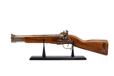 Vintage wooden rifle on a black stand,isolated on white background Stock Photo