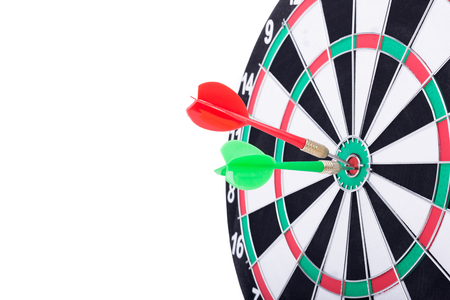 consistency: Right on target concept using dart in the bullseye on dartboard business success concept