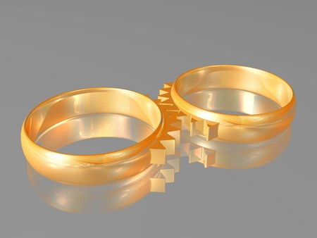 Two wedding gold rings with elements of gear wheels - a symbol of matrimonial relations.