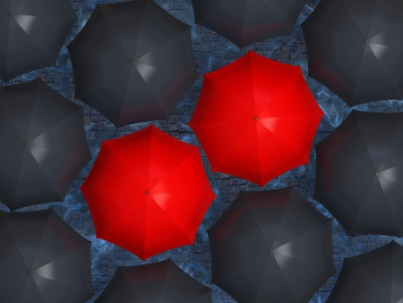 Two red umbrella, surrounded by black umbrellas