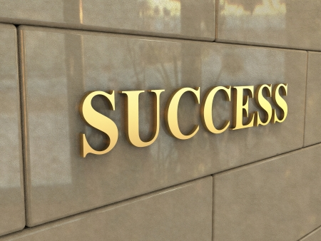 The word Success is chiseled by gold letters on a stone wall. Stock Photo