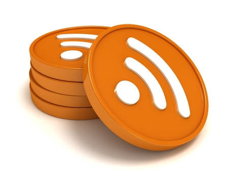 syndication: RSS symbol. Symbols RSS stacked by a pile, close up on a white background.