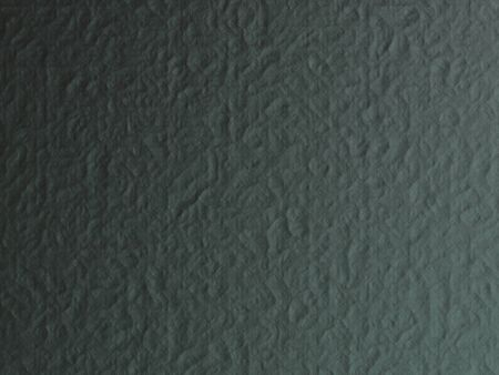 Grunge dark gray texture with uneven lighting for background.