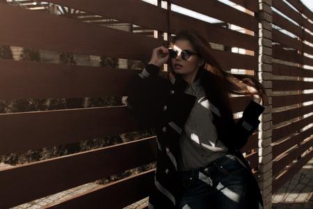 Girl in sunlight through the cracks