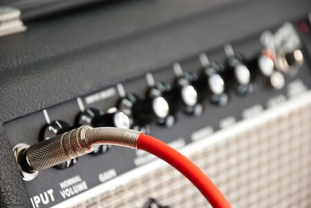 reverb: black guitar amplifier with red cord Stock Photo