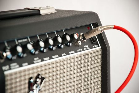 guitar amplifier: black guitar amplifier with red cord Stock Photo