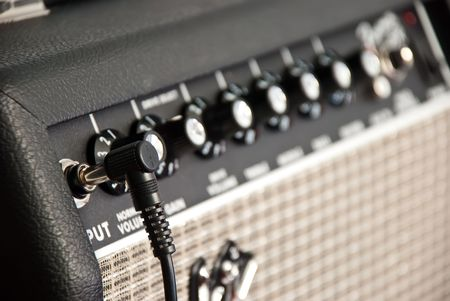 black guitar amplifier with black cord photo