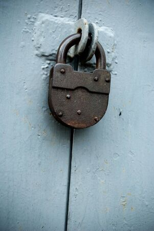 old rusted lock on a blue gate photo