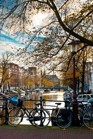bicycle in amsterdam with canal and sky