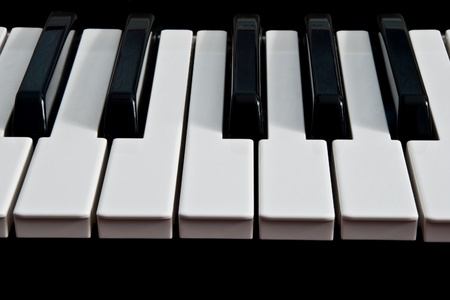 piano keyboard isolated on black background photo