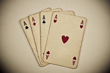 vintage playing cards on grey background photo