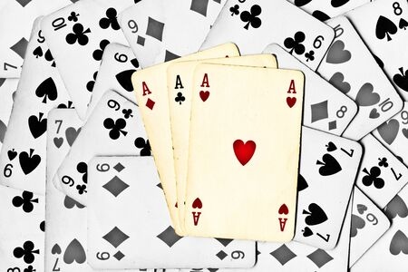 three color aces on a black and white cards background Stock Photo - 9199199