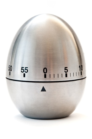 in readiness: egg timer isolated on a white background