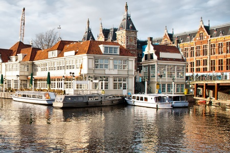 beautiful Amsterdam picture with canal, boats and architecture photo