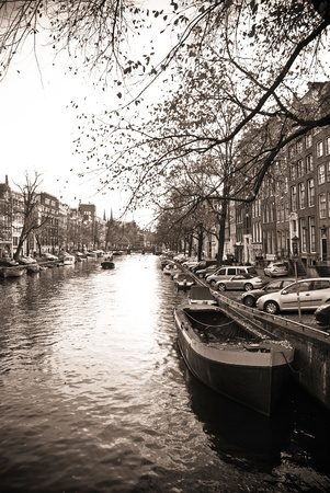 beautiful Amsterdam picture with canal, boat and houses photo