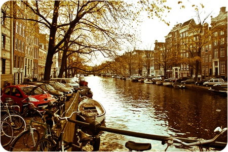 beautiful Amsterdam picture with canal, boats and architecture