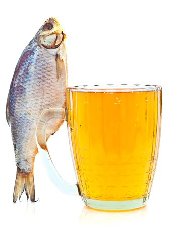 salted fish on a beer mug isolated on a white background photo
