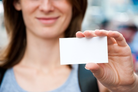 woman holding empty white card Stock Photo