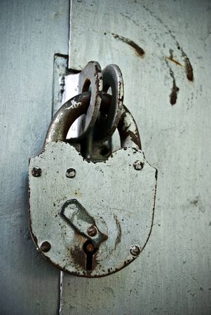 old rusted lock on a gate photo