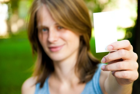 woman holding empty white card Stock Photo - 10520371