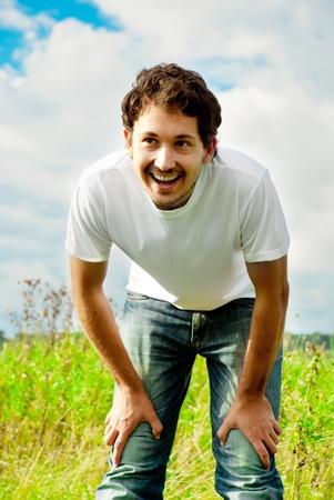 man standing in a beautiful field