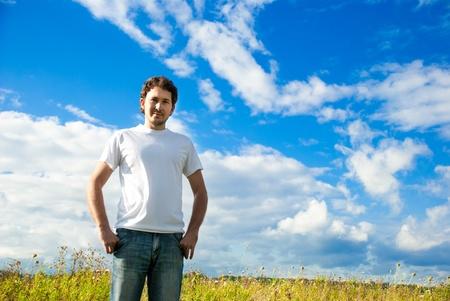man standing in a beautiful field photo