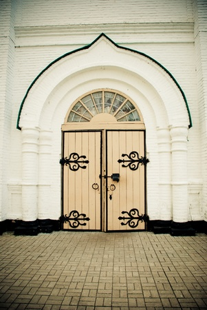 old wooden gates in a church photo