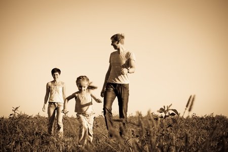 happy family in a meadow photo