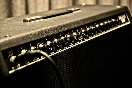 black guitar amplifier with switches and knobs Stock Photo - 11065173