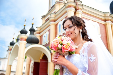 bride with bouquet at the church photo