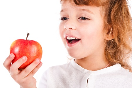 holding head: girl eating apple isolated on a white background